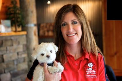 Heidi Ganahl holding puppy